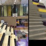 Gymzaal/aula met open geklapte tribune en de centrale trapopgang